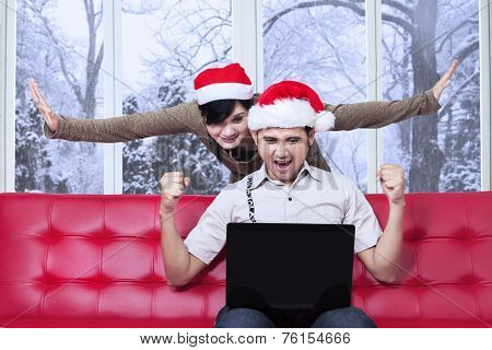 Pleased Couple After Pay Online On Christmas Day