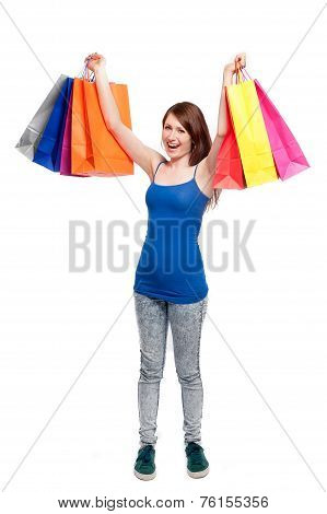 Happy Teenage Girl With Bright Coloured Shopping Bags