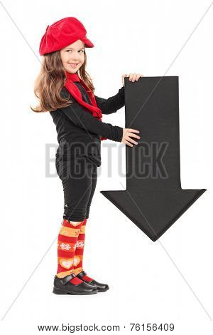 Profile shot of a little girl holding an arrow pointing down isolated on white background