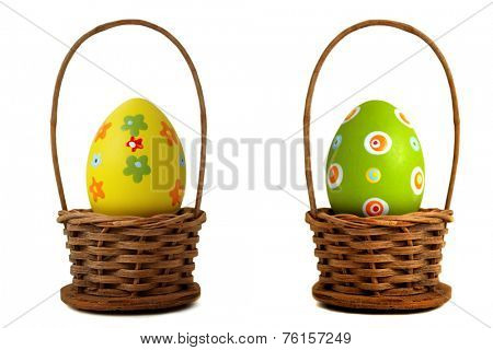 Yellow Easter egg into a basket on white background