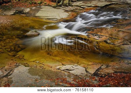 River Cascade In Mountain Forrest