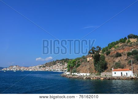 View of port city on the hillside in greece