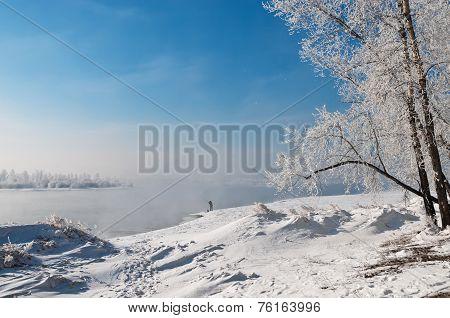 Beautiful Winter Landscape With Fisherman