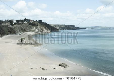 Retro-styled image of Tenby Beach in South Wales, UK.