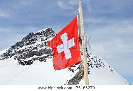 switzerland flag on Jungfrau mountain