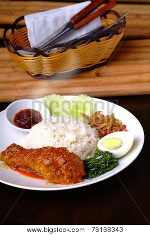 Nasi Lemak Traditional Malaysian Spicy Rice Dish.