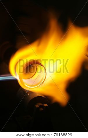 Chemical Glassware With Fire Background.