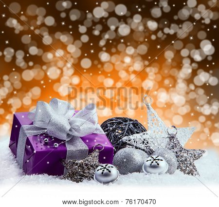 Purple Christmas package , gift of a silver ribbon. Jingle bells , silver christmas balls and christ