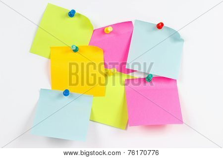Colorful stickers on white message board