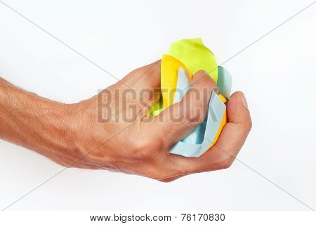 Hand grasps the paper trash on white background