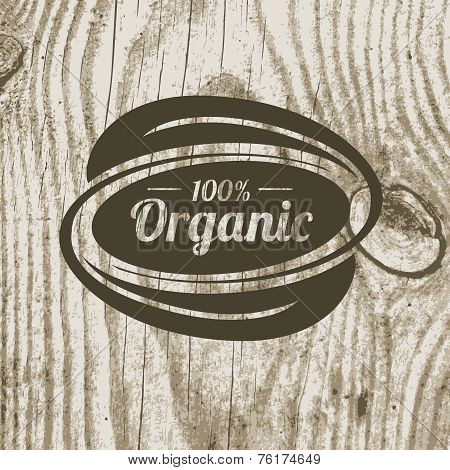 Organic Product Badge With Leaves On Wooden Texture. Vector Illustration Background. Logo Template