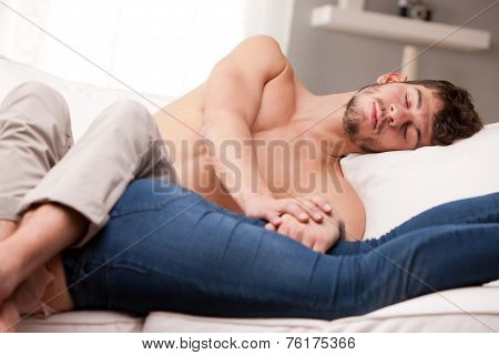 Mand And Woman Sprawling On A Sofa And Sleeping