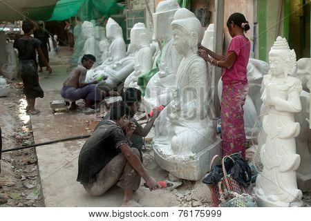 Burmese Man Carving And Woman Polishing  A Large Marble Buddha Statue.