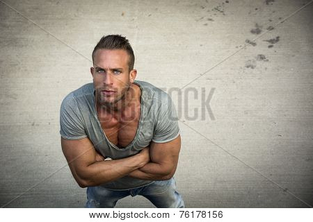 Handsome Blond Muscular Man Shot From Above, Looking Up