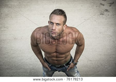 Shirtless Muscular Man Shot From Above, Looking At Camera