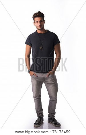 Full Figure Of Handsome Young Man Standing Confident In Casual Clothes