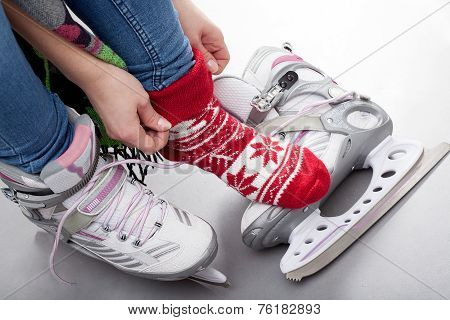 Girl Preparing For Ice Skating