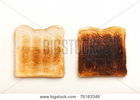 Two Toasted Slices Of Bread, Perfect And Burnt