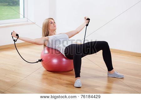 Woman Training On Fitness Ball