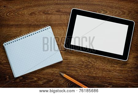 Blank Tablet And Notebook On A Wooden Table