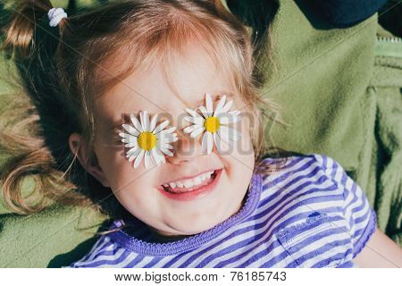 Beautiful happy girl  with flowers