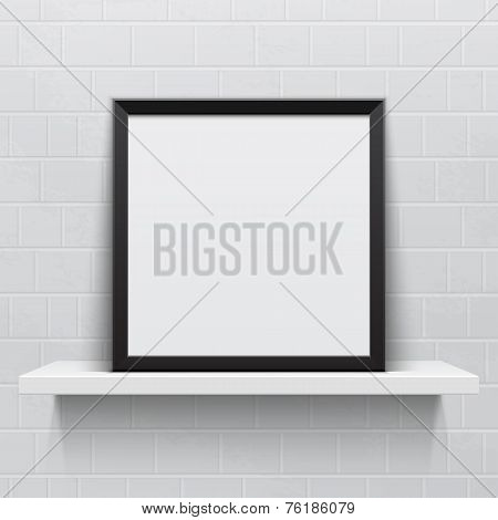 Realistic picture frame on white realistic shelf, against brick wall