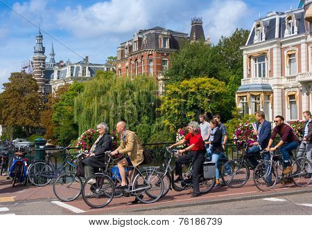 AMSTERDAM - AUGUST 29: People move around the city by bike on August 29, 2014 in Amsterdam. Amsterdam is considered the bicycle capital of the world.