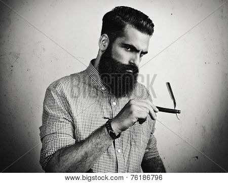 B/w Portrait Of A Bearded Man With Straight Razor