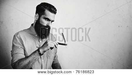 B/w Portrait Of A Brutal Man With Straight Razor