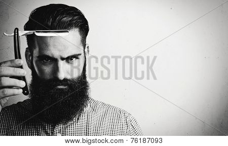 B/w Portrait Of Brutal Man With Vintage Straight Razor