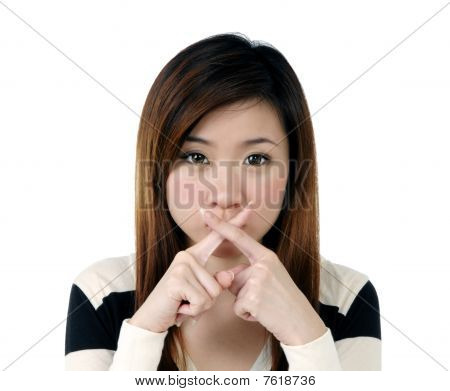 Pretty Young Woman Showing Crossed Sign With Fingers Over Her Lips