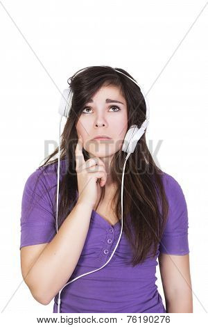 Brunette woman in headphones looking up dumbfounded isolated on white