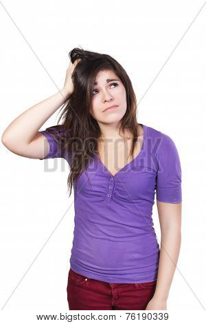 Brunette woman looking up scratching her head dumbfounded isolated on white
