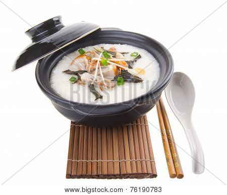 Traditional Chinese Pork Porridge Rice Gruel Served In Claypot