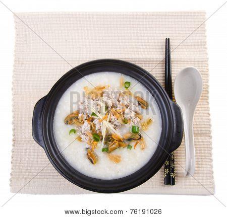 Traditional Chinese Pork Porridge Rice Gruel Served In Claypot