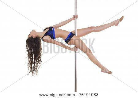 Young beautiful brunette girl doing pole dancing exercise. isolated on white
