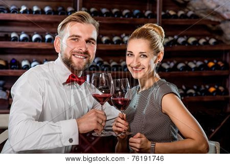 Couple having romantic wine tasting at the cellar