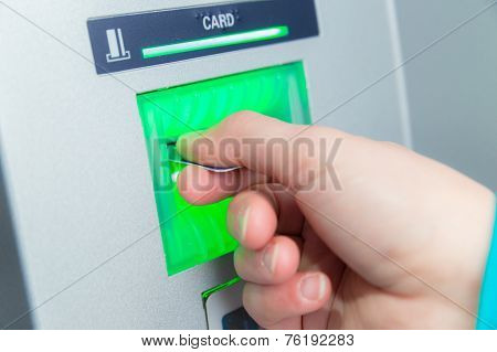 Woman Inserting Her Bank Card At An Atm