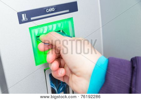 Woman Inserting Her Credit Card At An Atm