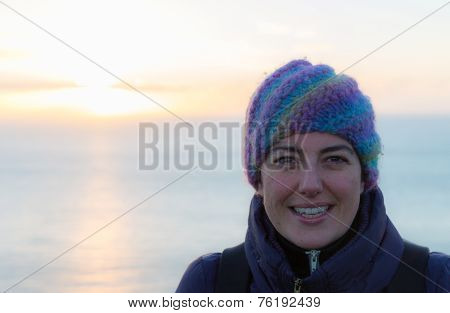 Portait Of A Smiling Lady With Woollen Hat