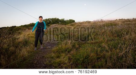 Active Woman Jogging Downhill Early Morning