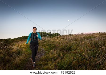 Active Woman Sprinting Downhill Early Morning