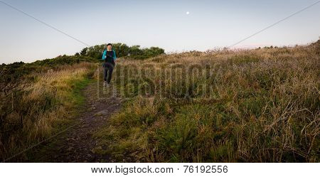 Active Woman Running Downhill Early Morning