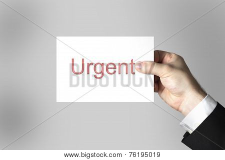Hand Holding White Card Urgent