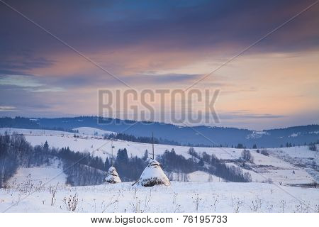 Snowy Haystack On The Background Of The Carpathian Mountains And Valleys