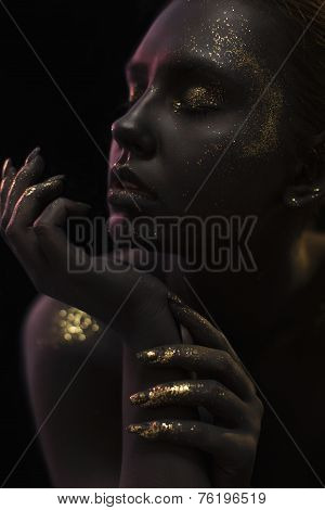 Close up portrait of a Woman on black background with the glitters and sparkles all over the black s