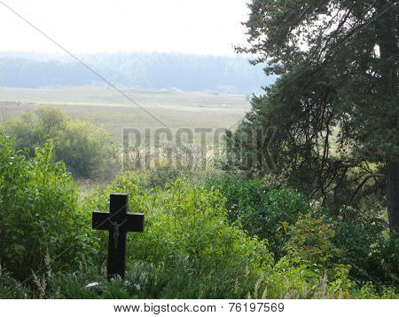 Old, abandoned grave on a hill