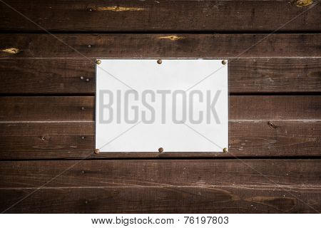 clean empty standard sheet on a wooden wall