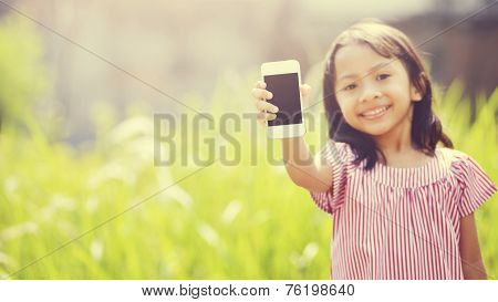 Happy Girl Playing Outdoor With Cellphone