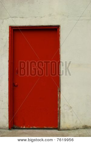 Red Door In An Off-White Stucco Wall